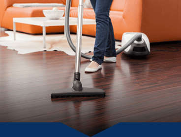 Housekeeper cleaning a wood floor